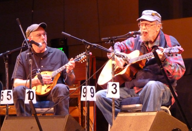 Juneau's Pat Henry, right, and Bob Banghart, left, performing as We're Still Here in April's festival. The two are the only musicians to have played at all 40 events. (Ed Schoenfeld/CoastAlaska)
