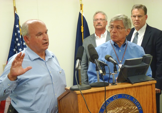 B.C. Mines Minister Bill Bennett discusses the week's mine meetings as Lt. Gov. Byron Mallott and other state officials listen during a Wednesday press conference. (Photo by Ed Schoenfeld/CoastAlaska News).